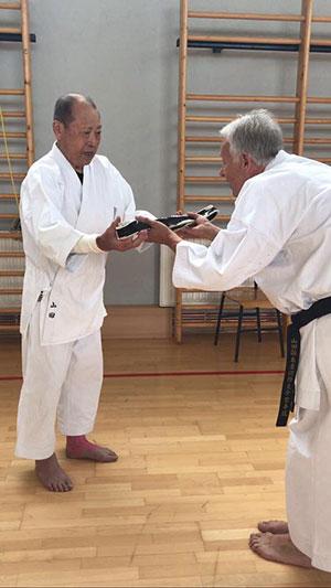 Master Yamada presenting Denis Casey sensei